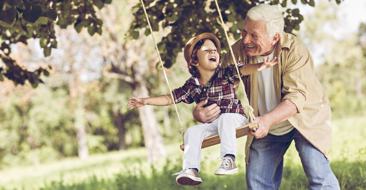 Playful grandfather spending time with his grandson